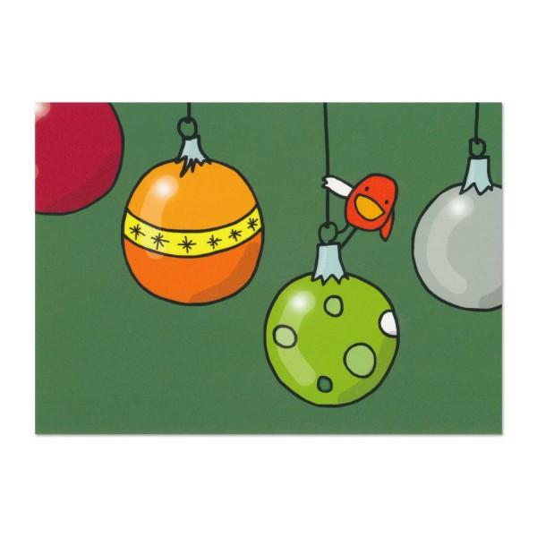 Postkarte Norbert hängt an einer Weihnachtskugel