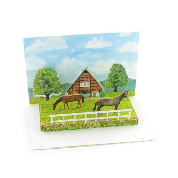 Pop-up-karte mit einer Pferdekoppel
