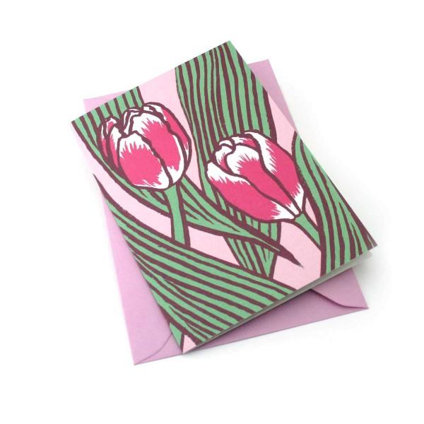 Klappkarte mit Tulpen vor rosa Hintergrund
