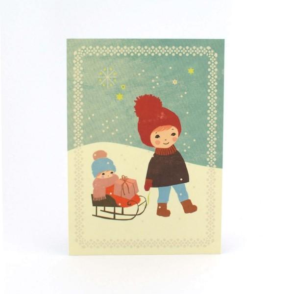 Weihnachtskarte Kind mit Schlitten