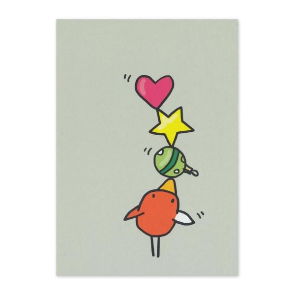 Postkarte Norbert jongliert mit Weihnachtskugeln